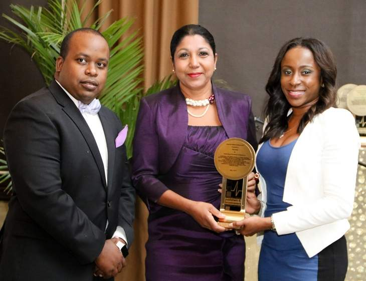 Awarded: Daren Lee Sing, president of the Trinidad and Tobago Publishers and Broadcasters Association (TTPBA), Shida Bolai, centre, awardee for Media ­Excellence, and Tricia Henry, public relations manager of title sponsor Huawei, pose at the TTPBA's annual dinner and awards for media excellence at Jaffa ­restaurant, Queen's Park Oval, Port of Spain, on Wednesday night.